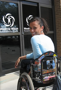 Smiling client in wheelchair entering WWRC